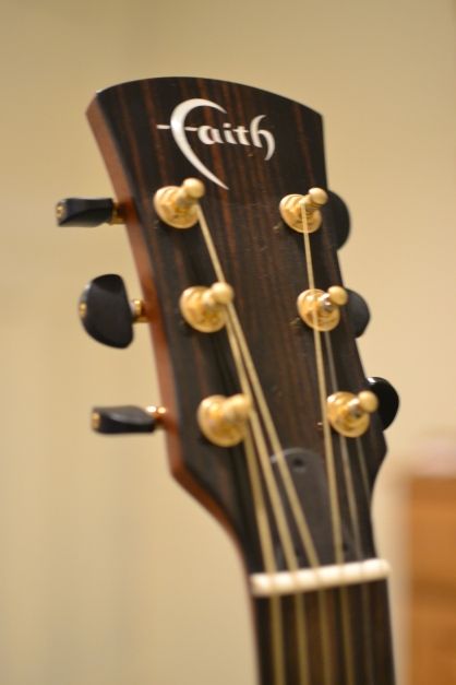 Tusq nut and ebony tuners.