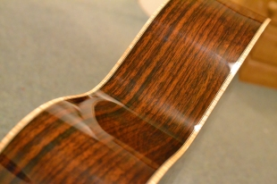 Solid rosewood back and sides.